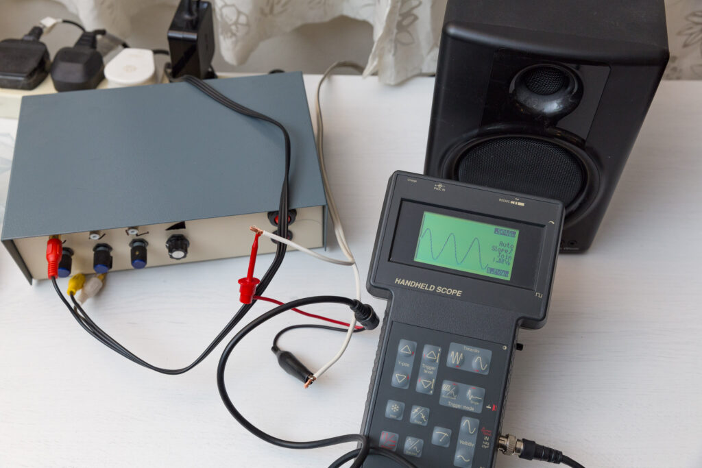 Handheld oscilloscope with sine wave