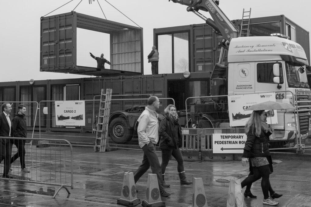 Crane lifting cargo container frame