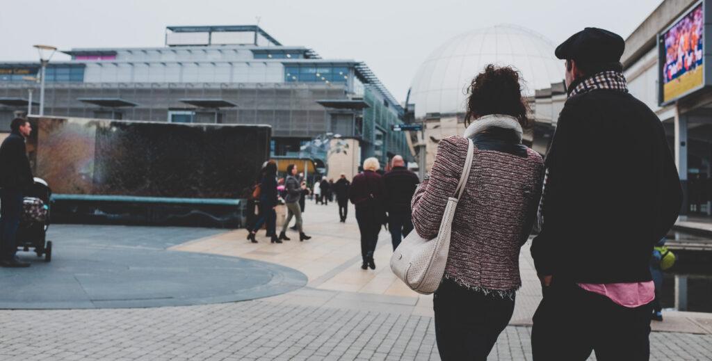 Couple entering Millennium Square, Bristol