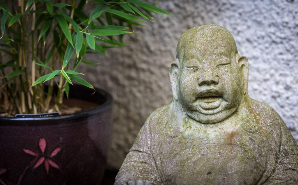 Stone buddha, and bamboo