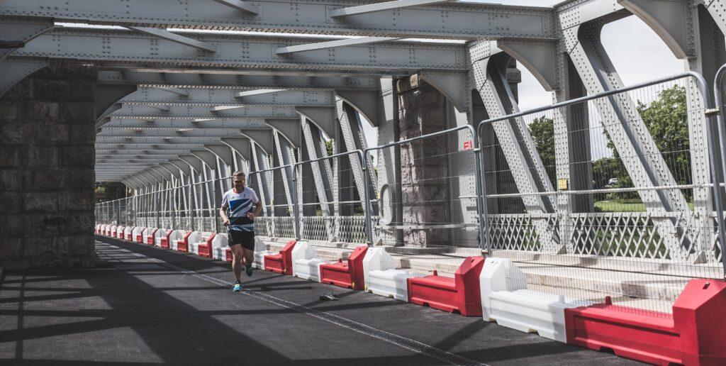 My friend Rob jogging across Ashton Avenue Bridge