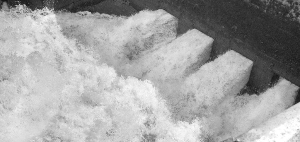 Water raging through a sluice