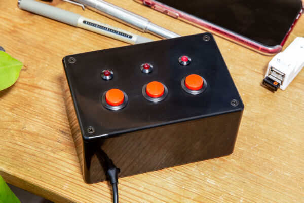 The finished box with three red buttons and three red LEDs.