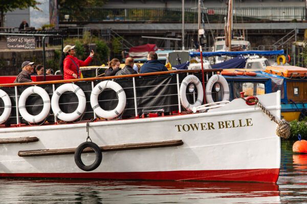 Large tour boat Tower Belle in Bristol harbour, with socially-distanced groups of tourists on board