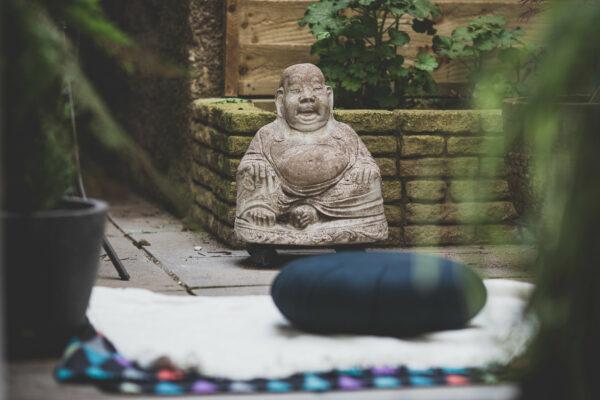 Stone Buddha in courtyard garden