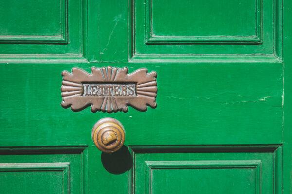 Letter box in green front door